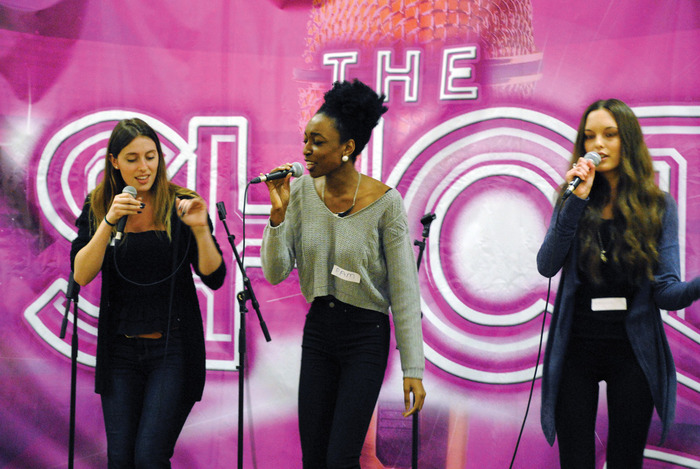 From left: Students Jessica Bell from Wilfrid Laurier, Pam Olayemi from Wilfrid Laurier, and Melissa Koehler from University of Waterloo sing during a mentoring session at the Waterloo Inn as part of The Shot vocal contest. Bell and Olayemi are two of the eight finalists.